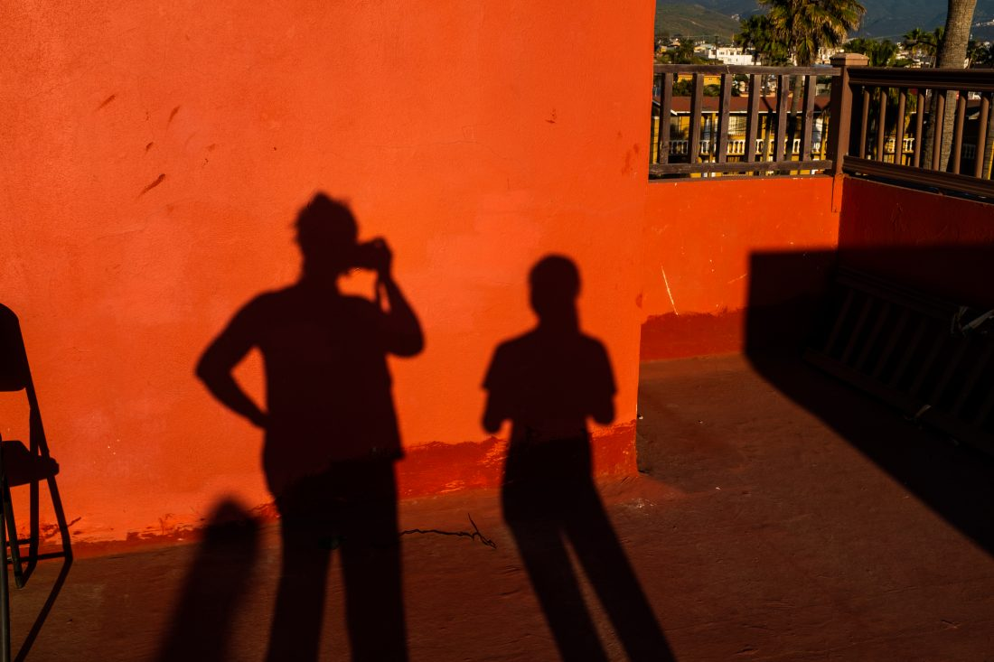 sillouette of photographer and child.
